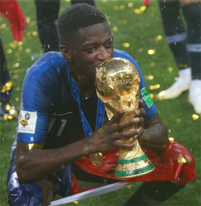 French player holding World Cup trophy