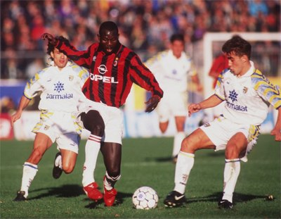 George Weah with the ball on football pitch