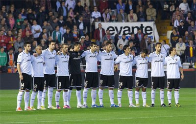 Valencia players stadning on the pitch